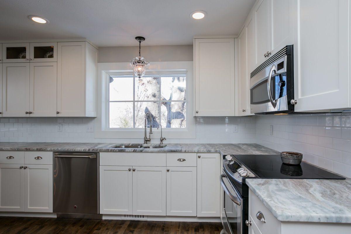 Kitchen with hard wood floor and tile backsplash, custom construction services
