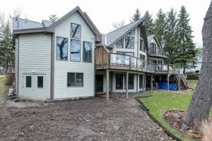 Back Left view of Custom home with large deck and trees