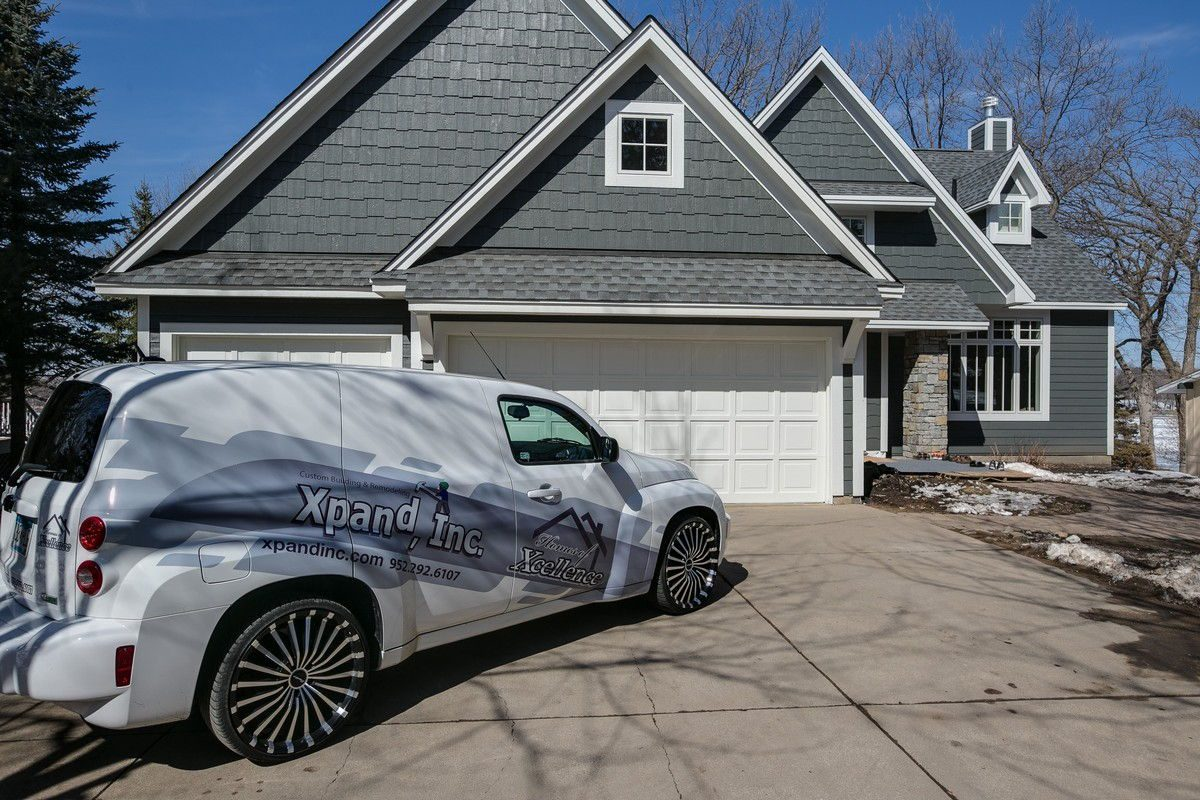 front of house with Xpand Vehicle