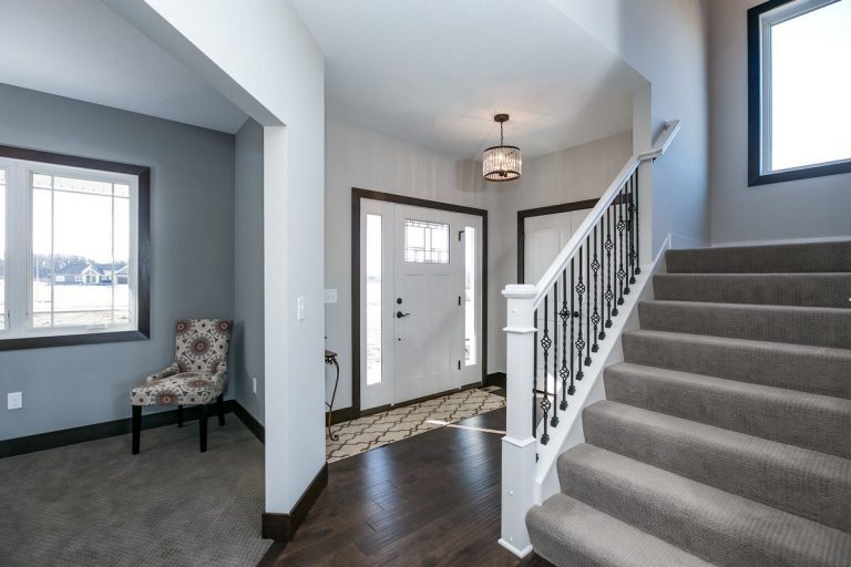 Foyer with hard wood floors and chandelier