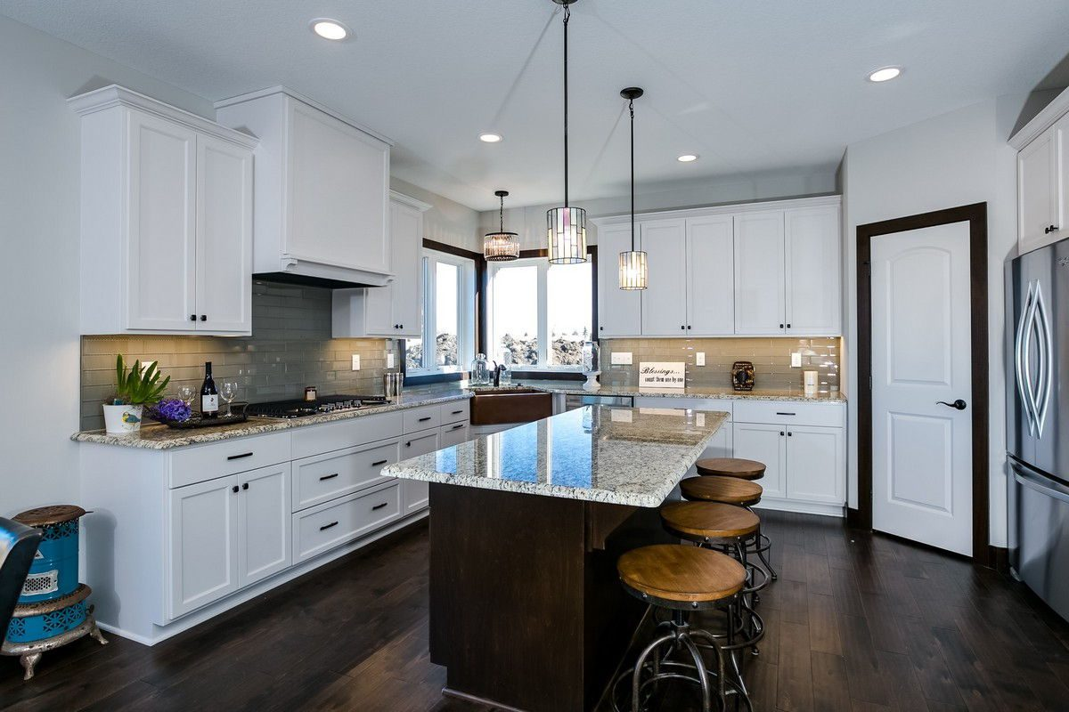 Kitchen with white cabinetry and island