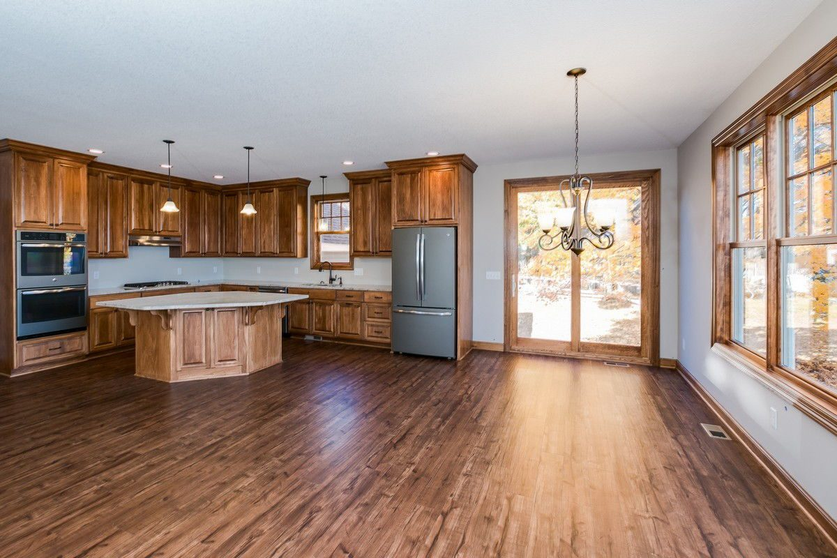 Dining & Kitchen area with chandelier and sliding door