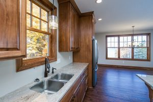Kitchen Sink Area with chandelier in dining area
