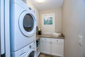 Small laundry room with cabinet space and small window