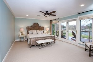 Master bedroom with recessed lighting and ceiling fan
