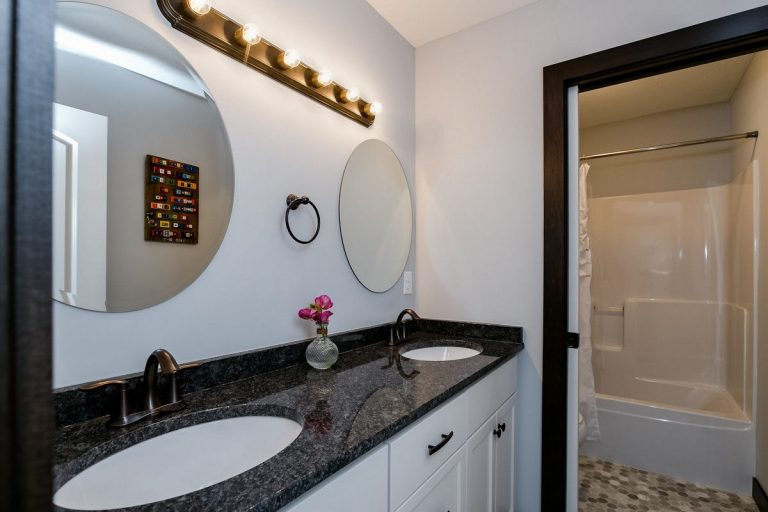 Two sinks and a separate door for toilet and shower