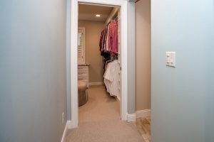 hallway to master bedroom closet