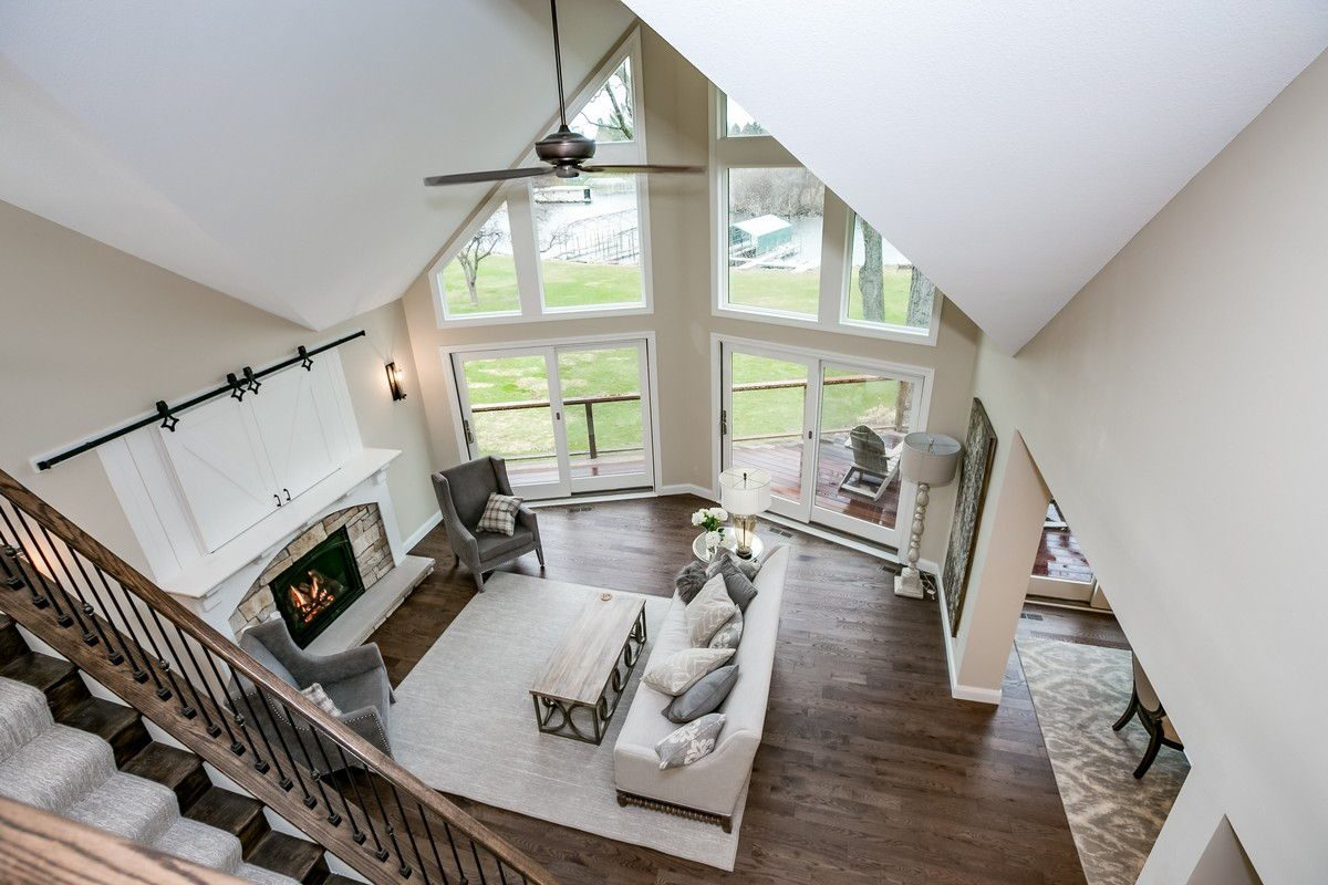 Stairway view overlooking family room with very large windows