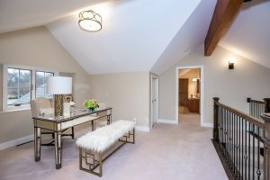 loft or office space with vaulted ceilings