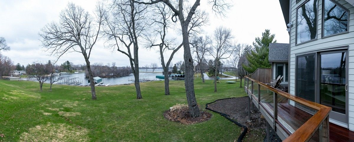 View of backyard of house and lake