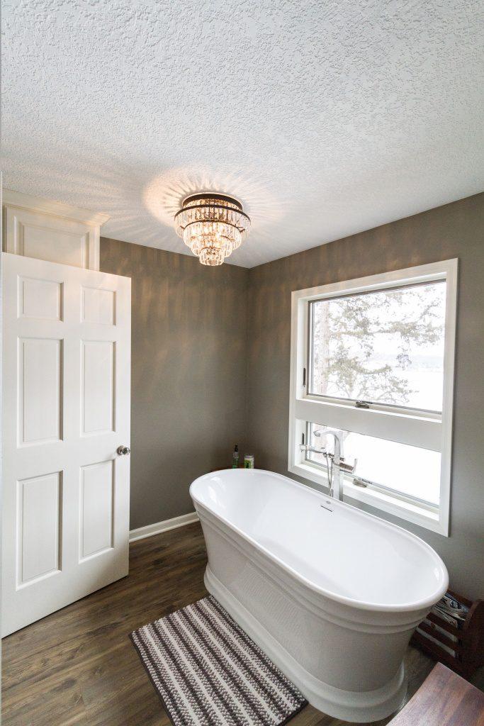 Bathroom with tub and window