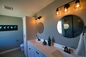 Bathroom with open counter and two mirrors