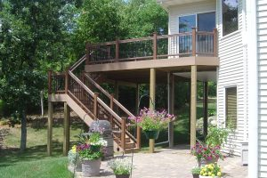Deck leading to lower level patio.