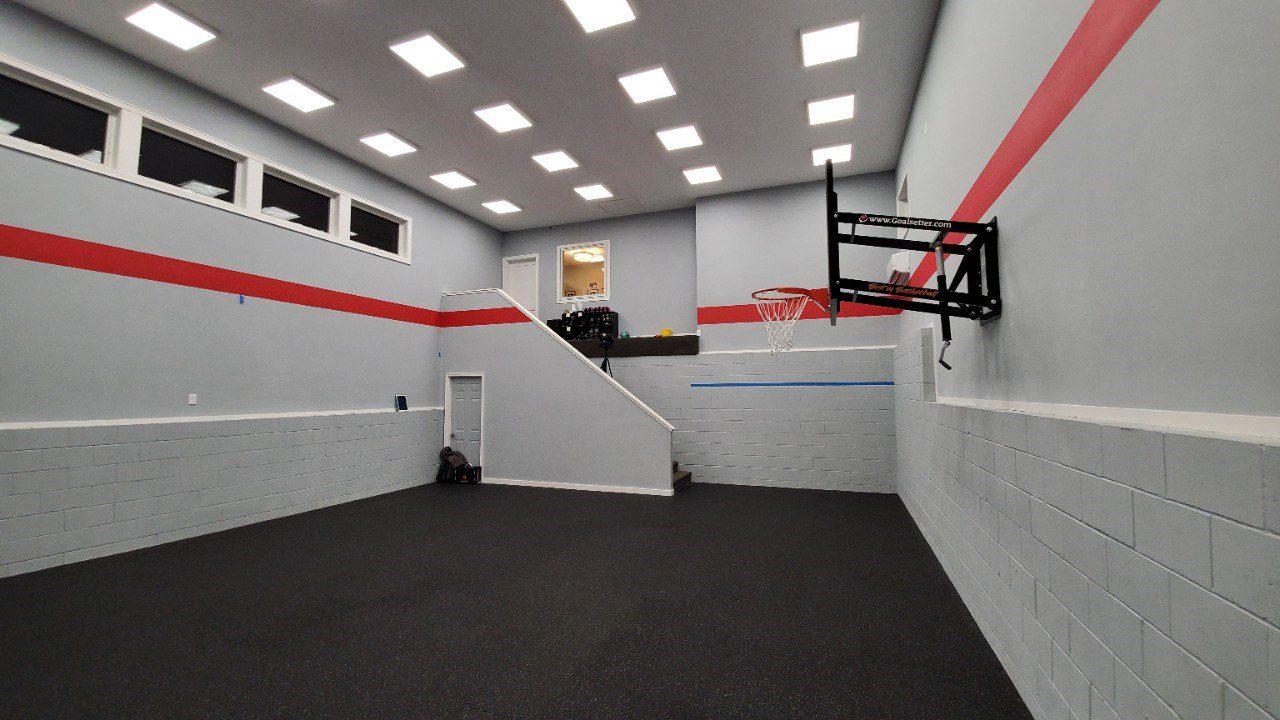 indoor sport court with a basketball hoop