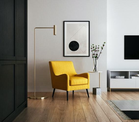 yellow chair sitting in a finished room
