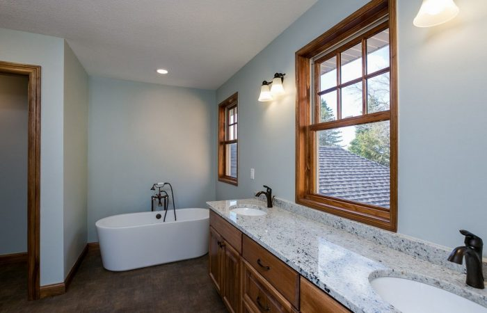 Master Bathroom with dual sink and windows