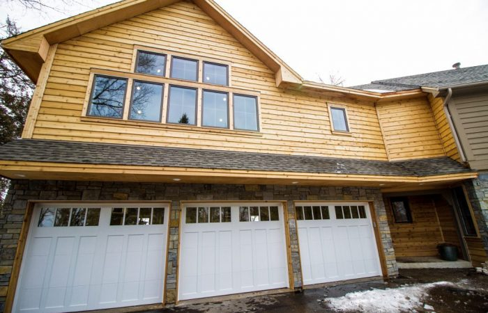 Front of 3 car garage with living space above.