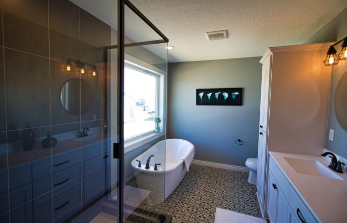 Bathroom showing tub and shower